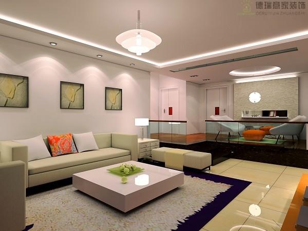 客厅:富有立体感的家具,把整体的现代风格体现的淋漓尽致,用透明玻璃隔断的休闲区,使得家里更舒适温馨。