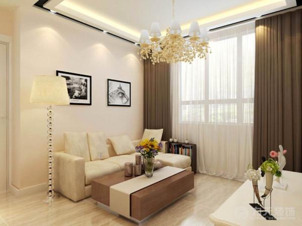 沙发背景墙是两幅富有现代气息的装饰画,餐厅整体色调与客厅相对应,厨房布置成了开放式厨房,使空间感增强