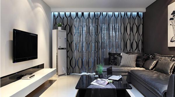 推门而入,首先映入眼帘的是极简单的白石膏背 景搭配黑镜,辅以白色电视柜,显得黑白有序, 简约而不简单,深咖色沙发背景墙配白色简单荷 花国画,整体看上去颜色深浅的搭配自然和谐。