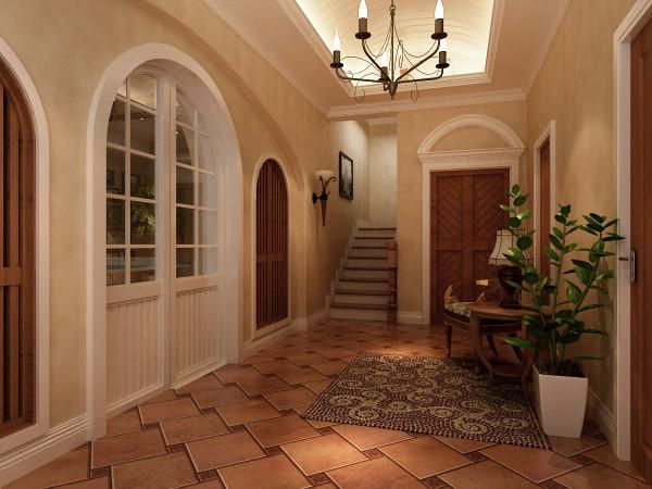 门厅与客厅之间的拱形门也是托斯卡纳风格常见的户型设计,拱形设计给人视觉上高度提高,墙面半高护墙板造型和顶面完美结合,整个空间更统一协调,也使整个空间增添了活泼的氛围,绿色植物让空间富有生命力。