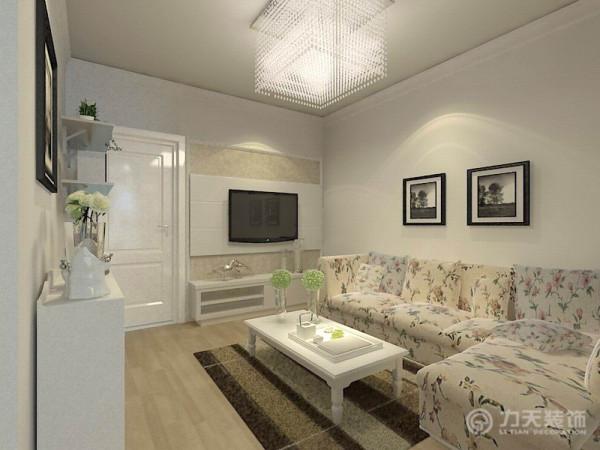 客厅的位置通过沙发背景墙,电视背景墙,挂画等装饰,使整个家庭色调很精彩。客厅运用石膏板拉缝和壁纸的结合使电视背景墙彰显品味。而沙发墙运用照片的各种装饰的表现形式,更加彰显业主的品味与内涵