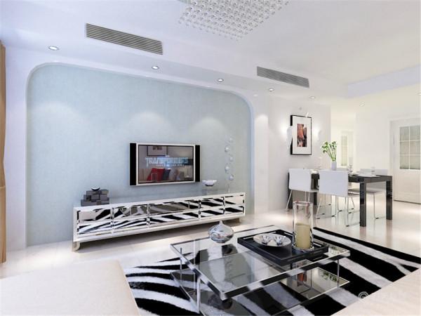 把电视背景墙划分为电视背景墙和餐厅背景墙两个部分,并在餐厅背景墙上挂了和沙发背景墙一样的具有中国元素的挂画和具有现代意义的壁灯,来增加空间中的点光源。客厅灯则选择了现代艺术感特别强的水晶吸顶灯。