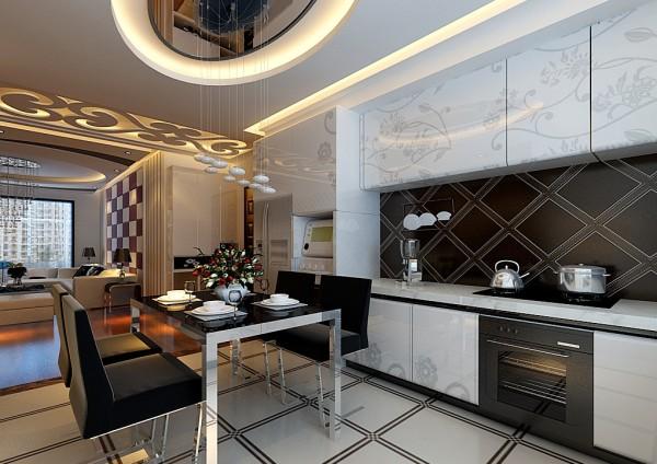 厨房做成开放式的,黑白色的橱柜配上黑白色的餐桌椅,尽显高端品质生活;椭圆形的吊顶跟客厅相得益彰。