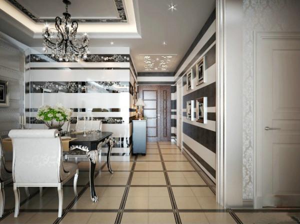 餐厅区的墙面利用印花镜面和不规则分隔的条状卫主题,让空间更有层次和进深感。