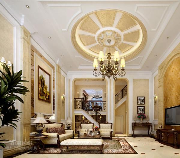 客厅与楼梯之间垭口的设计是通过改造立柱形成的,这样设计使空间分割更明确,同时将顶面与立面联系在一起,空间感觉更通透。