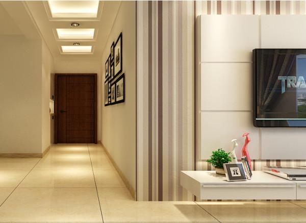 门口内嵌式的鞋柜与收纳方便日常生活,灯光柔和充足使业主入户就能享受温馨氛围。