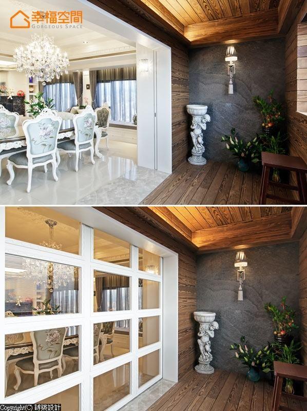 设计师采用门框与拉门的意象,区分餐厅与阳台空间,并采用薄片石材作为壁面,特殊碳化南方松为地坪与天花质材,刻划出休闲舒适氛围。