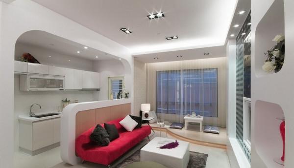 客厅的电视主墙以黑色玻璃配上圆点造型成功吸睛,一旁柜体以扁方的置物空间再次诠释普普风。