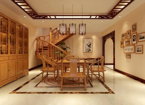 半旋转式的楼梯让餐厅有了很好的空间区分。中式的餐桌,酒柜配上浅咖色的地面拼花让餐厅显得明亮宽敞