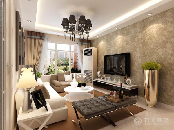 户型整体设计风格为现代简约,整体以浅咖色调贯穿。首先是电视背景墙,这里没有做过多的造型,满贴浅咖色印花壁纸,在家具的选用上也以简单的黑白色为主,简单大气。