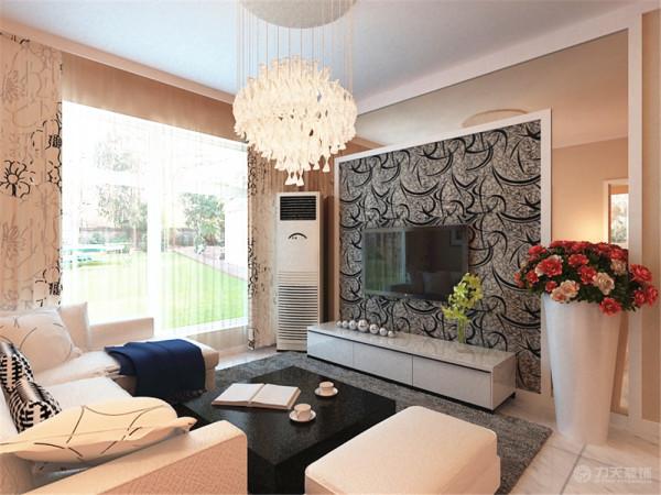 在过来的客厅部分,大的窗户,使空间采光性很好,沙发的选用,是与餐椅相同的白色皮质的L型沙发,深色的地毯,让空间层次分明,沙发墙部分则采用了两幅大型挂画,让空间色彩丰富起来