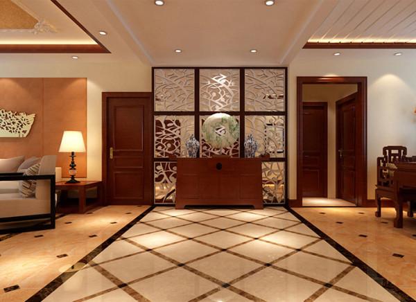 在门厅设计中,地面的拼花与墙面雕花镜子的设计,围合出了一种新中式主题氛围。屏风隔断的设计,既保证了门厅的完整性,又减弱了空间的封闭感。
