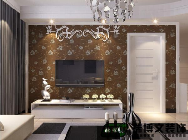 电视墙用石膏条做框架,壁纸打底。用浅色调,重色调作对比