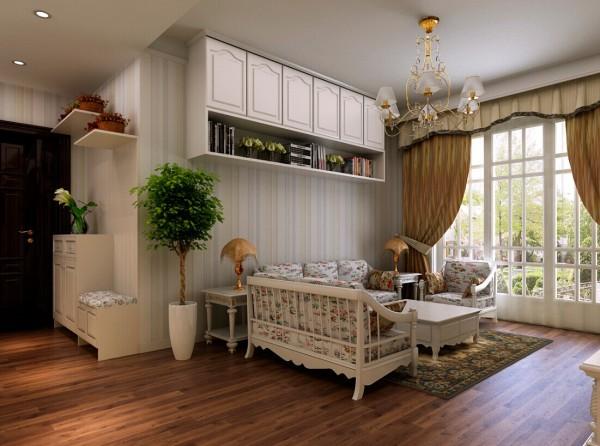 为了增加储物空间,在沙发背景墙上安装的壁柜,摆放一些作者平时喜欢的书籍。田园的小灯,休闲式的沙发,在窗明几净的氛围里,是不是有种很惬意的感觉。