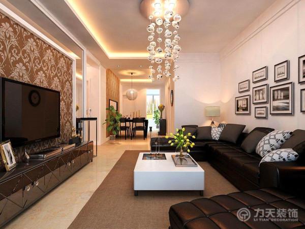 沙发为黑色皮质,茶几为现代烤漆和高亮不锈钢腿相结合,电视柜也为现代烤漆材质 与高亮不锈钢材质相结合,电视背景墙为现代壁纸和镜面造型结合石膏线