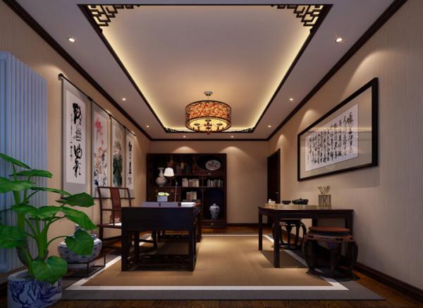 中式的顶部角花的运用,中式的书案,在加上文房四宝,纸。墨笔砚。中式字画的运用。整个空间充满书香味。