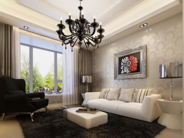 客厅以浅金色花纹壁纸作为背景,一副业主喜爱的艺术壁画,简约大方。吊顶为双层顶,既摒弃了欧式的繁琐,又不失欧式的韵味。