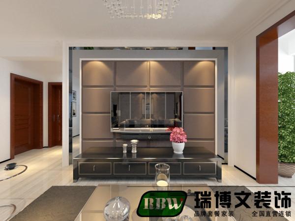 电视墙采用石膏板造型,壁纸呼应,层次清晰,打磨光滑,富有立体感,和餐桌区域划分空间。