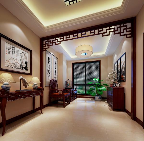 休闲区用了中式的花格把入户门分隔开来,红木家具的太师椅,中式字画,显的休息区非常有文化气息,看的出业主具有文化修养的