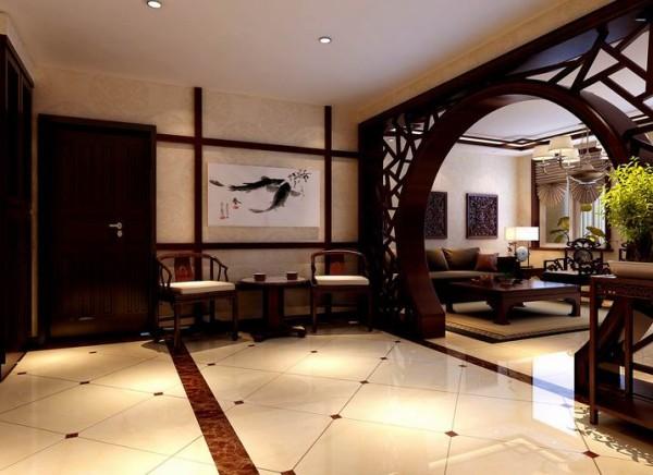 客厅和门厅的中间隔断采用了弧形的屏风,既有装饰效果又起到了通风的作用。