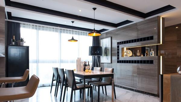 直线型的家具与墙面,圆形的灯饰,刚与柔的结合。