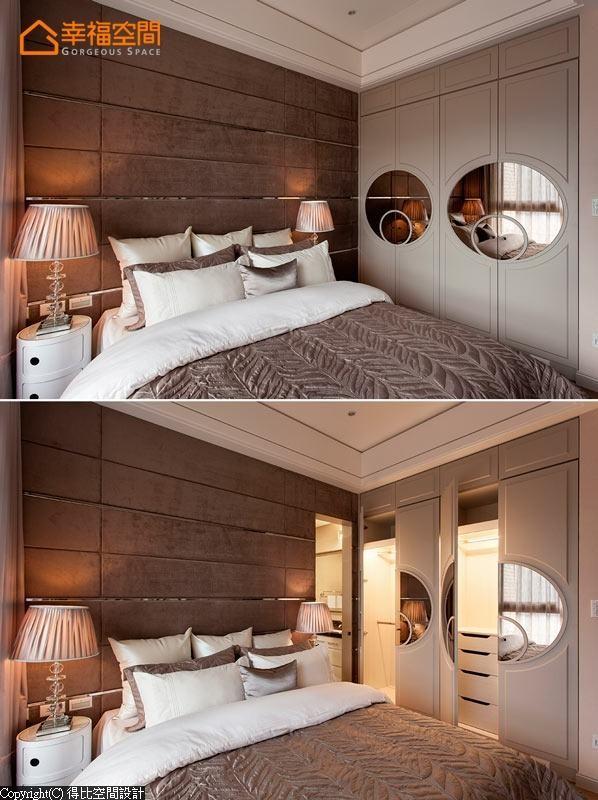 主卧的收纳衣柜同样运用奢华的元素,使用圆形的镜面装饰营造出时尚感。