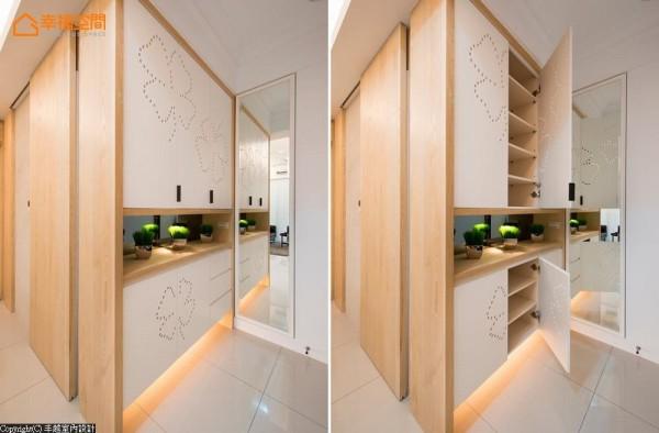 端景柜兼具鞋柜功能,幸运草图样的镂空圆孔,除了造型美观之外,更能使内部保持良好的通风。而在穿衣镜的后方,则用隐藏的方式规划电箱与弱电箱的位置。