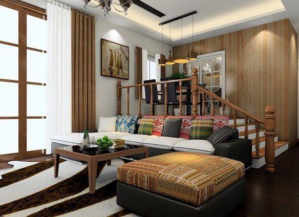客厅比较宽敞,沙发后面的位置不想空着,又不想摆放笨重的储物柜,可以用梯台营造一个小区域,让空间更有层次感。