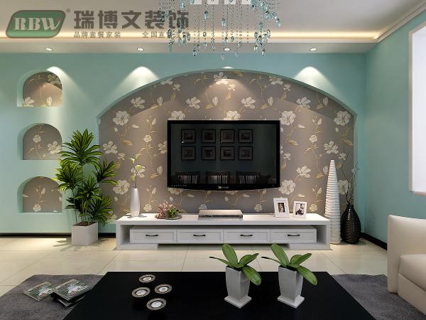 电视墙采用石膏板做拱形造型结合壁纸,环保装饰性好。(电视墙过于长,在多出部分做了拱形造型)。