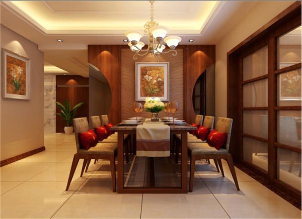 【成都实创装饰】东南亚风格—三居—整体家装—餐厅装修效果图 餐厅背景墙用胡桃木做了弧形的造型,既增加了空间的延展性,又使得餐厅背景墙的圆滑性。在水晶吊灯的配搭下,共演美妙的光影之舞。