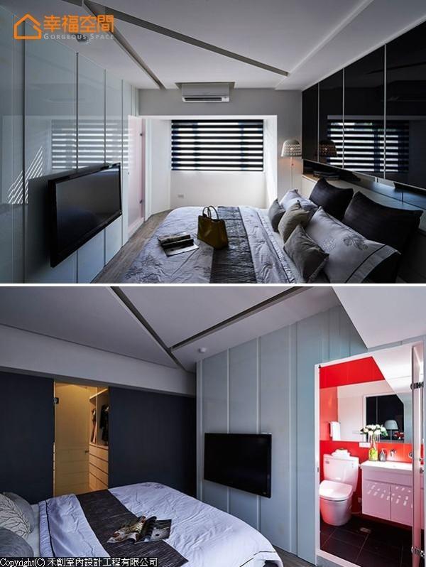凹凸立体呈现的烤玻墙面后,隐藏利用红色白膜玻璃放大空间的半套卫浴,而女主人专属的大更衣室则规划在床侧的透光门片后方。