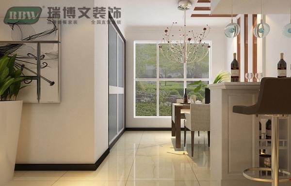 餐厅区域,顶面结合墙面整体设计,单独设计出餐桌区域。