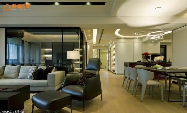 客厅与书房以黑、灰配色为主,餐厨区立面则以白色调铺陈;形成空间景深的层次变化。