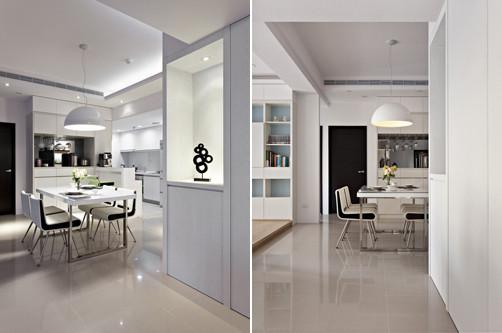 8、紧挨着书房是餐厅和厨房空间;同样我们可以看到白色的简洁收纳柜实用方便;在餐厅和客厅的墙面上设计一 个镂空的展示台,上面柔和灯光照射下一个简洁时尚的装饰品醒目突出。