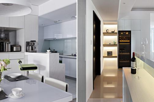 10、开放式的厨房简洁大方,白色的整体色调清爽洁净;在餐厅和厨房之间设计一个吧台,突出了空间的实用性 和具有界定性作用,上面摆放的咖啡机和远处的酒柜设计让我们可以看出主人很喜欢西方生活习惯。