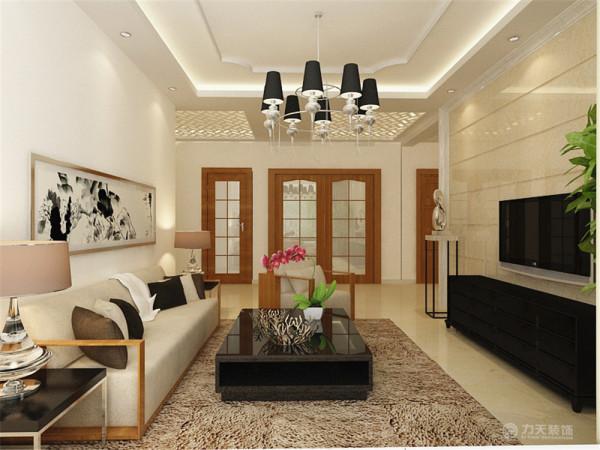 沙发背景较为简洁只挂一副中式的水墨画。电视背景墙采用石材拉缝和石材圈边。整体的家具的线条都简洁明了,体现了现代风格的特点。
