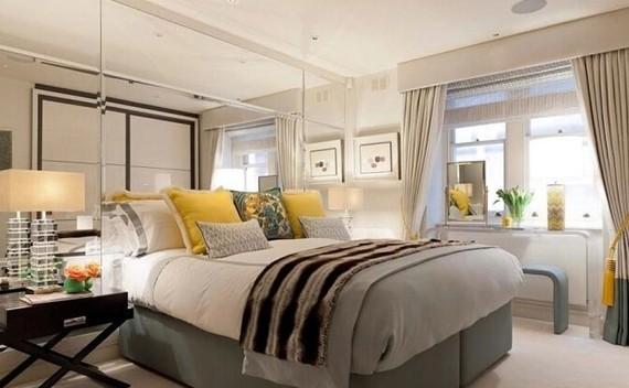 如果一个房间的装饰包含了大量的乳白色,这一定就是个充满自由气息的房间。床上、窗帘、飘窗台上的黄色装饰则让卧室充满了灵动。