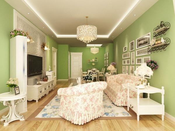客厅采用了绿色墙漆,突出了温馨质朴的感觉,沙发背景墙采用了多个相框来装饰空间。电视背景墙有砖的纹理,更有田园的感觉,和一些小的装饰品,点缀了空间为客厅增色不少