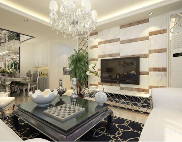 客厅白色的皮质沙发 ,柔软的抱枕,重色的地毯,使空间雅致、干净、大气,在温暖的的灯光下享受休憩的时光。餐厅极具简约线条美的皮质餐桌椅,使就餐成为一种愉悦的事