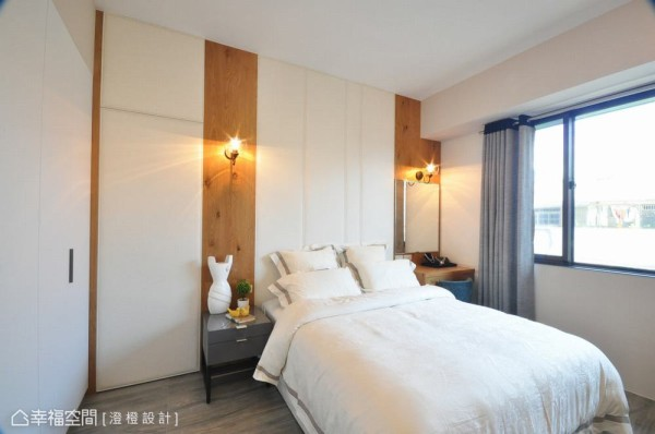 主卧室用色温婉,床头使用小牛皮与带有木节的钢刷木皮所构置,随意点上壁灯,轻松转换感官的体验。
