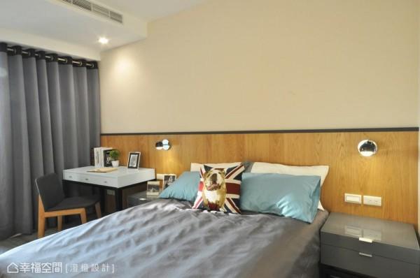 次卧的设计上,床头腰带下使用铁件及钢刷木皮表现,营造设计旅馆的氛围。