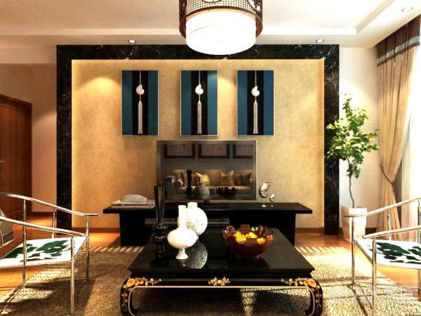 茶几和电视柜采用黑色烤漆材料,对面电视背景墙采用黑金沙石材圈边,中间铺贴米黄色壁纸,在石材里面打上暖色灯带,壁纸上悬挂三个蓝黑白相见的装饰物