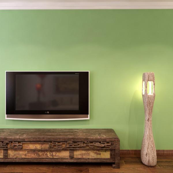 电视背景墙,简单而不失大气,单纯的颜色也能打造出很有品位的背景墙。古朴的电视柜,突出了文化的沉淀,提升客厅的典雅品味。
