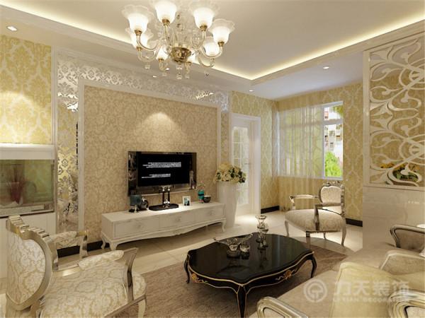 客厅的电视背景墙是以石膏线圈边,将壁纸与印花镜的融合,凹凸有致,立体感较强,墙体是以欧式黄色壁纸为整体,电视柜是以白色烤漆组成,显的整个空间比较亮堂。