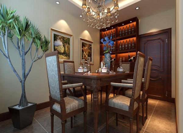 设计理念:本案餐厅为独立空间,米黄色的墙面,二级的灯池吊顶,复古奢华的水晶吊灯,实木的酒柜,高品质的洋酒,无处不突显出主任高品质的生活追求。