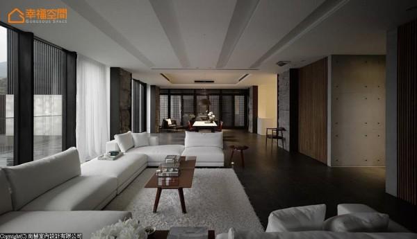 承袭着一楼公领域的主轴设计,格栅在二楼空间里衔接上了清水模,修整空间的雍容比例。
