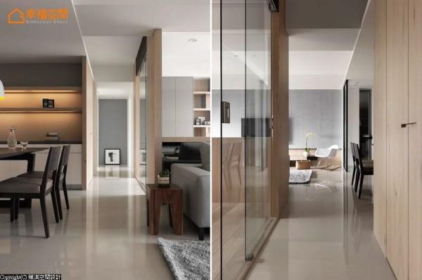 廊道空间形塑一条室内的长轴线,透过视觉延伸和异质材的立面铺陈,使心境可以在此转换、放松。