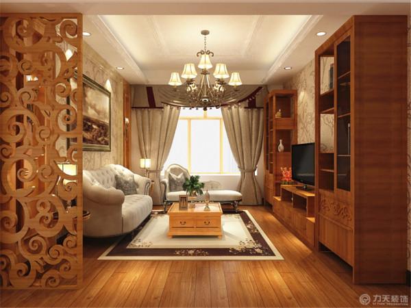 客厅设计中将欧式与美式的设计同时融入其中,木制家具、与沙发背景墙都是利用了美式的造型,但木色并没有采用传统的深木色,款式新颖的吊灯在其中最为显眼