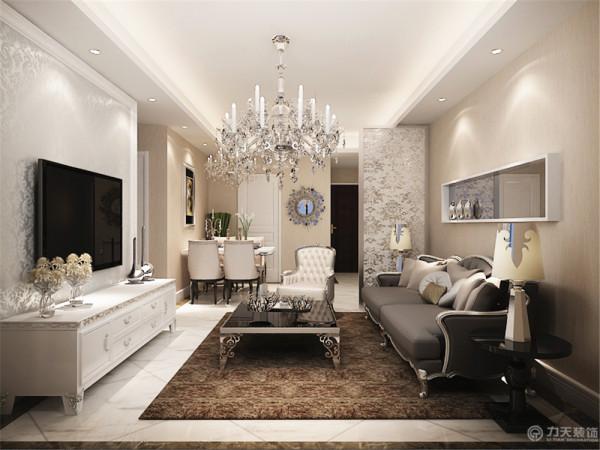 。电视背景墙选择了石膏线圈边加上了荧光碎花壁纸,沙发背景墙用一小块黑镜来装饰,增大了空间的尺度感