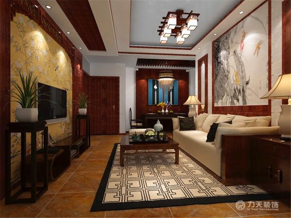 电视背景墙就是中还是特有的雕刻,边上是两盆兰花。地面铺贴的是仿古砖。